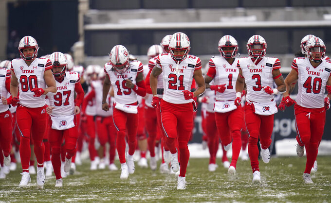 Utah players take the field to face Colorado in the first half of an NCAA college football game Saturday, Dec. 12, 2020, in Boulder, Colo. (AP Photo/David Zalubowski)