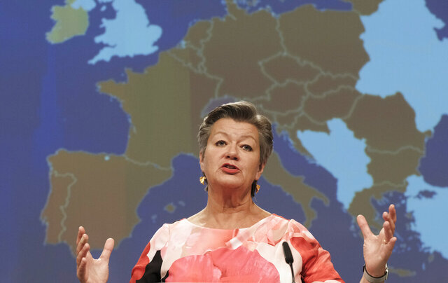 European Commissioner for Home Affairs Ylva Johansson addresses a video press conference at EU headquarters in Brussels, Thursday, June 11, 2020. The EU on Thursday announced plans to ease a ban on non-essential travel to the continent with foreign students, non-EU nationals who normally live in Europe and certain highly skilled workers likely to be exempt from the coronavirus restrictions from July 1. (Olivier Hoslet, Pool Photo via AP)
