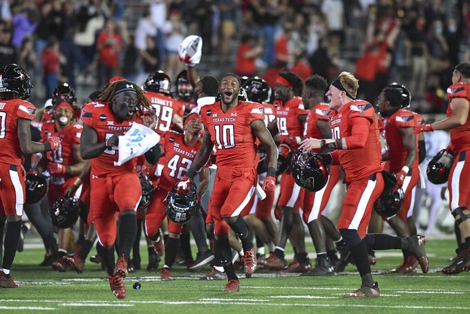 Texas Tech celebrates after defeating Baylor in an NCAA college football game in Lubbock, Texas, Saturday, Nov. 14, 2020. (AP Photo/Justin Rex)