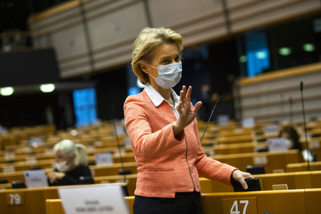 European Commission President Ursula von der Leyen, wearing a face mask to protect against the spread of coronavirus, gestures prior a plenary session at the European Parliament in Brussels, Wednesday, June 17, 2020. (AP Photo/Francisco Seco)