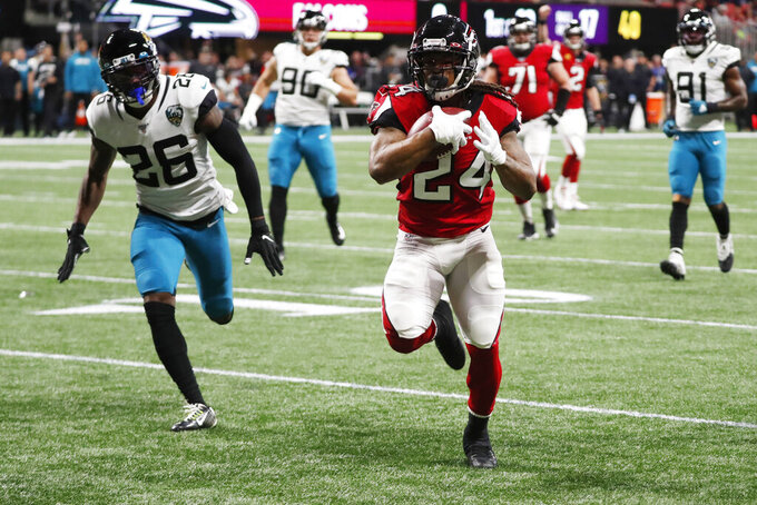 Atlanta Falcons running back Devonta Freeman (24) runs toward the end zone for a touchdown against the Jacksonville Jaguars during the first half of an NFL football game, Sunday, Dec. 22, 2019, in Atlanta. (AP Photo/John Bazemore)