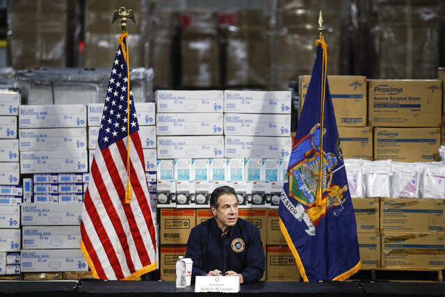FILE - In this Tuesday, March 24, 2020 file photo, Gov. Andrew Cuomo speaks during a news conference against a backdrop of medical supplies at the Jacob Javits Center that will house a temporary hospital in response to the COVID-19 outbreak in New York. Cuomo, a Democrat, ripped the GOP-led Senate's version of the coronavirus package as