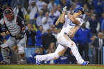 Los Angeles Dodgers' Corey Seager reacts after striking out with the bases loaded for the final out, as Washington Nationals catcher Kurt Suzuki celebrates in Game 2 of a baseball National League Division Series on Friday, Oct. 4, 2019, in Los Angeles. (AP Photo/Mark J. Terrill)