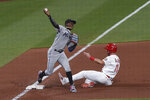 St. Louis Cardinals' Paul DeJong, right, is out at third as Miami Marlins shortstop Jazz Chisholm Jr. throws out Adam Wainwright at first during the eighth inning of a baseball game Tuesday, June 15, 2021, in St. Louis. (AP Photo/Joe Puetz)