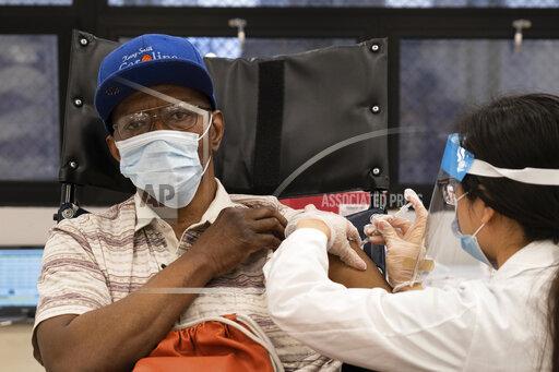 Virus Outbreak US Surge
