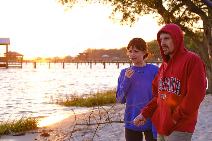 "This image released by Gravitas Ventures shows Dakota Johnson, left, and Casey Affleck in a scene from ""Our Friend."" (Claire Folger/Gravitas Ventures via AP)"