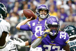 Minnesota Vikings quarterback Kirk Cousins, center, throws a pass during the first half of an NFL football game against the Philadelphia Eagles, Sunday, Oct. 13, 2019, in Minneapolis. (AP Photo/Bruce Kluckhohn)