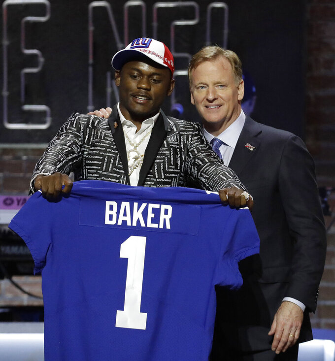 Georgia defensive back DeAndre Baker poses with NFL Commissioner Roger Goodell after the New York Giants selected Baker in the first round at the NFL football draft, Thursday, April 25, 2019, in Nashville, Tenn. (AP Photo/Steve Helber)