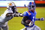 Florida wide receiver Kadarius Toney (1) runs for a 16-yard touchdown as he gets past Missouri linebacker Devin Nicholson during the second half of an NCAA college football game Saturday, Oct. 31, 2020, in Gainesville, Fla. (AP Photo/John Raoux)