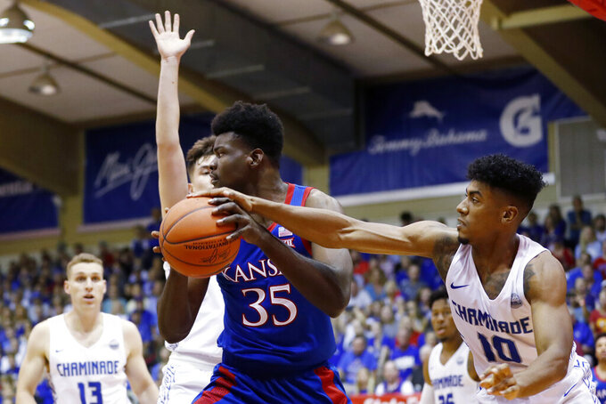 Chaminade guard Andre Arissol (10) slaps the ball away from Kansas center Udoka Azubuike (35) during an NCAA college basketball game Monday, Nov. 25, 2019, in Lahaina, Hawaii. (AP Photo/Marco Garcia)