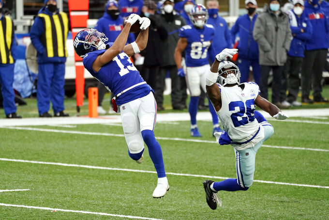 New York Giants' Dante Pettis, left, makes a catch in front of Dallas Cowboys' Xavier Woods during the first half of an NFL football game, Sunday, Jan. 3, 2021, in East Rutherford, N.J. Pettis ran the ball in for a touchdown. (AP Photo/Corey Sipkin)