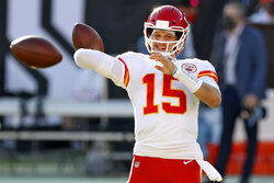 Kansas City Chiefs quarterback Patrick Mahomes (15) throws a pass before an NFL football game against the Tampa Bay Buccaneers Sunday, Nov. 29, 2020, in Tampa, Fla. (AP Photo/Mark LoMoglio)