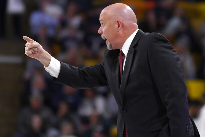UTSA head coach Steve Henson talks to his team as they play Utah State in the first half of an NCAA college basketball game Monday, Nov. 18, 2019, in Logan, Utah. (AP Photo/Eli Lucero)