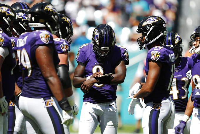 Baltimore Ravens quarterback Lamar Jackson (8) looks at a play, during the second half at an NFL football game against the Miami Dolphins, Sunday, Sept. 8, 2019, in Miami Gardens, Fla. (AP Photo/Brynn Anderson)