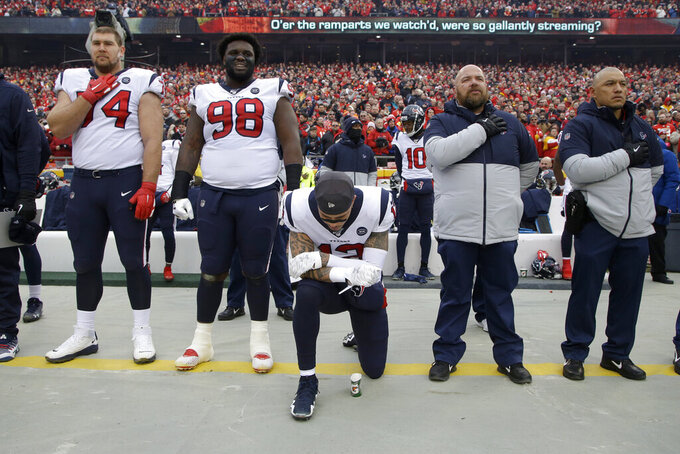 "FILE - In this Jan. 12, 2020, file photo, Houston Texans wide receiver Kenny Stills (12) kneels during the playing of the national anthem before an NFL divisional playoff football game against the Kansas City Chiefs in Kansas City, Mo. With every get-out-the-vote campaign, every shutdown of a major sport, every detailed list of actions athletes are demanding to combat America's racial inequities, it becomes clearer: The days of ""shut up and play"" are winding down. (AP Photo/Charlie Riedel, File)"