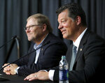 Minnesota Wild NHL hockey team owner Craig Leipold, left, smiles with new team general manager Bill Guerin at an introductory press conference in St. Paul, Minn., Thursday, Aug. 22, 2019.  (David Joles/Star Tribune via AP)