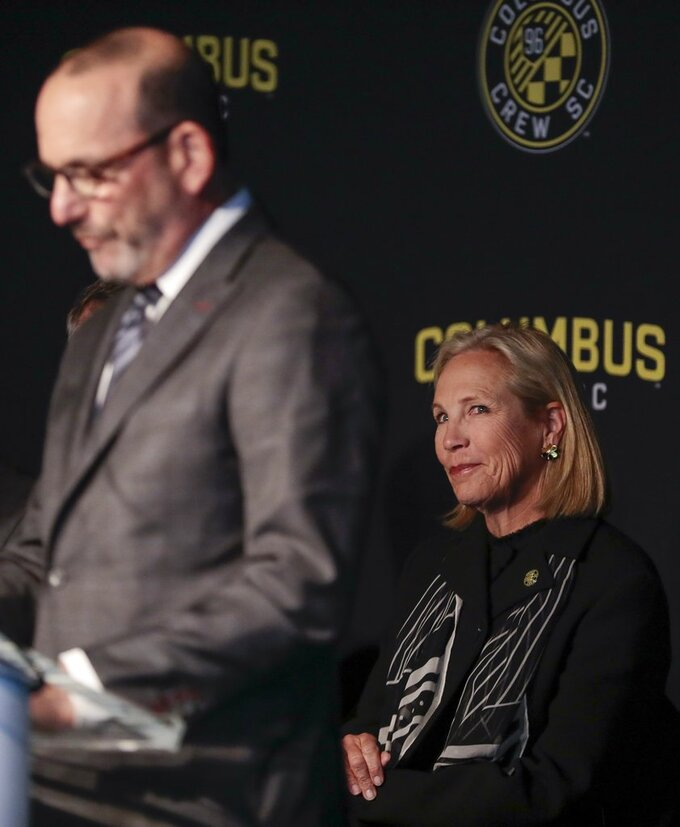Dee Haslam, right, a member of the ownership group for Columbus Crew SC, listens as MLS commissioner Don Garber speaks during a Columbus Crew SC introductory press conference in Columbus, Ohio, Wednesday, Jan. 9, 2018.  (Joshua A. Bickel/The Columbus Dispatch via AP)