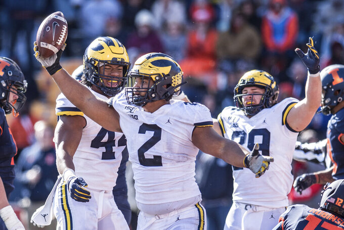 Michigan's Carlo Kemp celebrates an interception in the second half of an NCAA college football game against Illinois, Saturday, Oct.12, 2019, in Champaign, Ill. (AP Photo/Holly Hart)