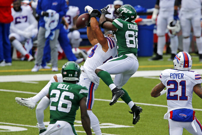 Buffalo Bills outside linebacker Matt Milano (58) intercepts a pass intended for New York Jets wide receiver Jamison Crowder (82) during the first half of an NFL football game in Orchard Park, N.Y., Sunday, Sept. 13, 2020. (AP Photo/John Munson)
