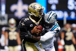 Carolina Panthers defensive end Brian Burns sacks New Orleans Saints quarterback Jameis Winston during the second half of an NFL football game Sunday, Sept. 19, 2021, in Charlotte, N.C. (AP Photo/Jacob Kupferman)