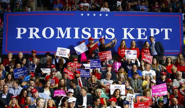 FILE - In this Nov. 5, 2018, file photo, supporters of President Donald Trump wait for him to arrive to speak at a rally at Allen County War Memorial Coliseum, in Fort Wayne, Ind. Vice President Mike Pence has a favorite line when he introduces President Donald Trump at rallies. He says