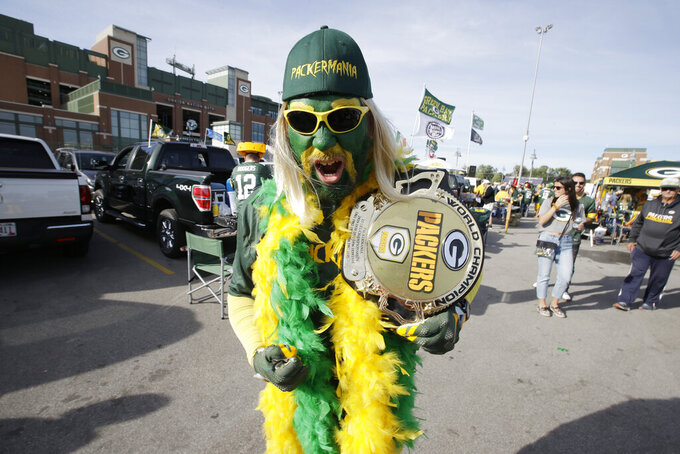 Green Bay Packers fan Brad Borcharet walks through the parking lot outside Lambeau Field before the start of an NFL football game between th Packers and the Philadelphia Eagles, Thursday, Sept. 26, 2019, in Green Bay, Wis. (AP Photo/Mike Roemer)