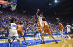 Kansas Jayhawks forward David McCormack (33) shoots over the Texas defense during the second half of an NCAA college basketball game in Lawrence, Kan., Monday, Feb. 3, 2020. (AP Photo/Reed Hoffmann)