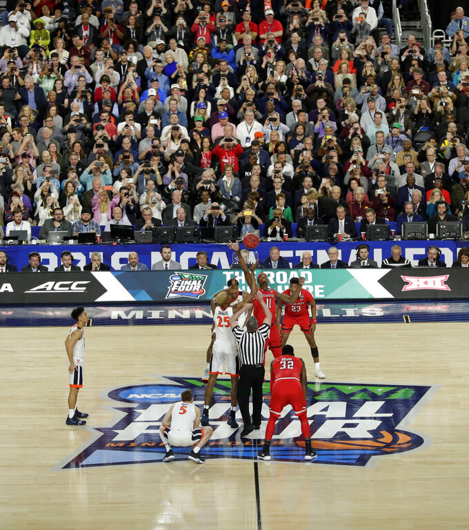 Virginia's Mamadi Diakite (25) and Texas Tech's Tariq Owens (11) reach for the tipoff at the start of the first half in the championship of the Final Four NCAA college basketball tournament, Monday, April 8, 2019, in Minneapolis. (AP Photo/Matt York)