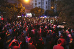 Fans gather outside the Jam Hospital where the nation's famous singer Mohammad Reza Shajarian has died of cancer at the age of 80, in Tehran Iran, Thursday, Oct. 8, 2020. Shajarian enlivened Iran's traditional music with his singing style, which soared, swooped and trilled over long-known poetry set to song. But the later years of his life saw him forced to only perform abroad, after he backed those who challenged the disputed re-election of hard-line President Mahmoud Ahmadinejad by telling state radio to stop using his songs. (AP Photo/Vahid Salemi)