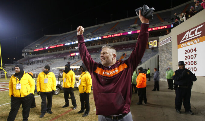 Virginia Tech head coach Justin Fuente celebrates his team's win over Virginia after an NCAA college football game in Blacksburg, Va., Friday, Nov. 23, 2018. Virginia Tech defeated Virginia 34-31. (AP Photo/Steve Helber)