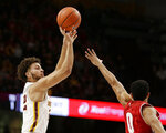 Minnesota guard Gabe Kalscheur (22) shoots over Wisconsin guard Payton Willis (0) during the first half of an NCAA college basketball game Wednesday, Feb. 6, 2019, in Minneapolis. (AP Photo/Andy Clayton-King)