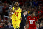 Maryland forward Donta Scott gestures after scoring a basket on Nebraska during the first half of an NCAA college basketball game, Tuesday, Feb. 11, 2020, in College Park, Md. (AP Photo/Julio Cortez)