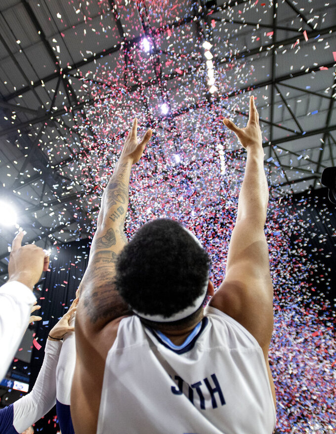 Old Dominion guard B.J. Stith celebrates in the confetti after his team defeated Western Kentucky 62-56 in an NCAA college basketball game for the Conference USA men's tournament championship, Saturday, March 16, 2019, in Frisco, Texas. (AP Photo/Jeffrey McWhorter)