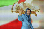 FILE - In this June 27, 2014 file photo, Maryam Rajavi, the leader of the National Council of Resistance of Iran, waves to well-wishers in Villepinte, north of Paris. Four people are going on trial in the Belgian city of Antwerp on Friday Nov. 27, 2020, accused of planning to bomb a rally of Iranian opposition supporters. The plot was thwarted by a cross-border intelligence operation that led to the arrest of a couple in Brussels. (AP Photo/Rermy de la Mauviniere, File)