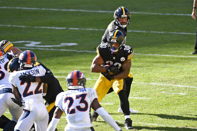 Pittsburgh Steelers quarterback Ben Roethlisberger (7) hands off to running back James Conner (30) during the second half of an NFL football game in Pittsburgh, Sunday, Sept. 20, 2020.  (AP Photo/Don Wright)