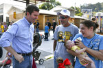 In this Saturday, Sept. 21, 2019, photo, Democratic candidate for governor, Kentucky Attorney General Andy Beshear, left, talks with supporters before the start of the Black Gold Festival Parade in Hazard, Ky. Beshear is making a big push for support in eastern Kentucky, a coal-producing region and stronghold for President Donald Trump. (AP Photo/Timothy D. Easley)
