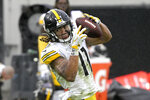 Pittsburgh Steelers wide receiver Chase Claypool (11) makes a reception against the Jacksonville Jaguars during the second half of an NFL football game, Sunday, Nov. 22, 2020, in Jacksonville, Fla. (AP Photo/Phelan M. Ebenhack)