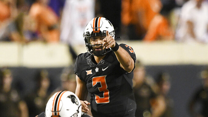 Oklahoma State quarterback Spencer Sanders (3) points to the endzone prior to taking the snap during an NCAA college football game Saturday, Sept. 25, 2021, in Stillwater, Okla. (AP Photo/Brody Schmidt)