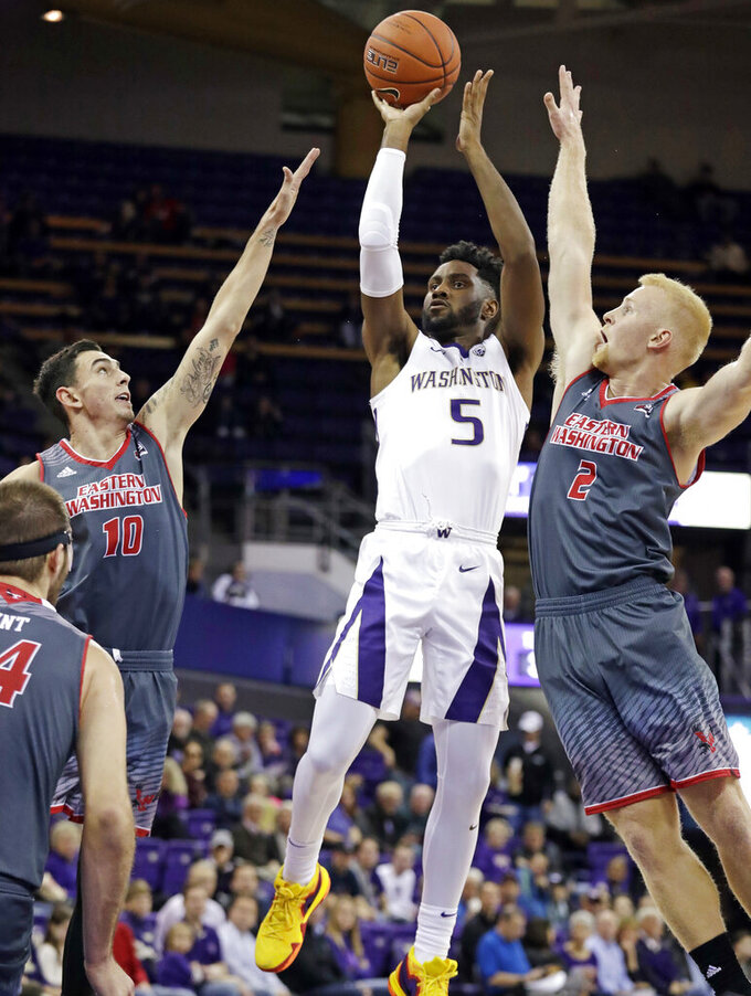 FILE - In this Nov. 27, 2018, file photo, Washington's Jaylen Nowell (5) shoots between Eastern Washington's Jacob Davison (10) and Ty Gibson (2) in the first half of an NCAA college basketball game, in Seattle. Nowell was named to the AP All-Pac-12 team, Tuesday, March 12, 2019. (AP Photo/Elaine Thompson, FIle)
