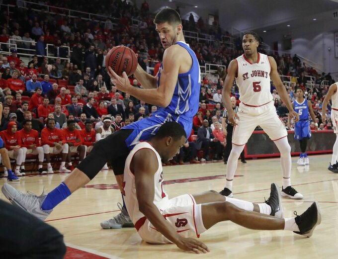 Creighton's Martin Krampelj, above, and St. John's Mustapha Heron fight for control of the ball during the first half of an NCAA college basketball game Wednesday, Jan. 16, 2019, in New York. (AP Photo/Frank Franklin II)