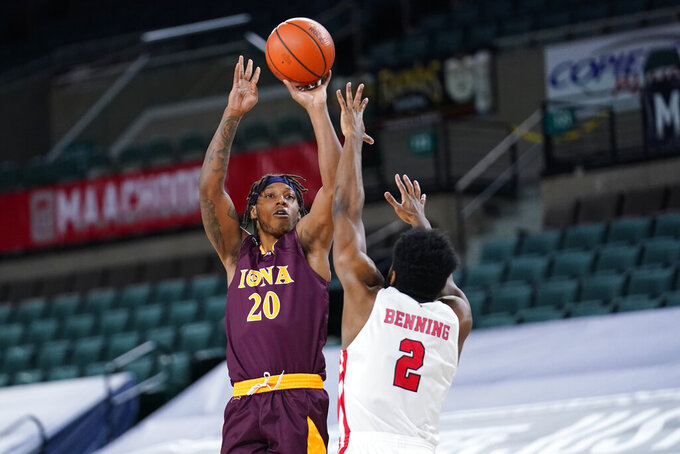 Iona's Isaiah Ross (20) goes up for a shot against Fairfield's Taj Benning (2) in the first half of an NCAA college basketball game during the finals of the Metro Atlantic Athletic Conference tournament, Saturday, March 13, 2021, in Atlantic City, N.J. (AP Photo/Matt Slocum)