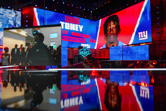 Images of Florida wide receiver Kadarius Toney are shown on stage after he was chosen by the New York Giants with the 20th pick in the first round of the NFL football draft Thursday April 29, 2021, in Cleveland. (AP Photo/Tony Dejak)