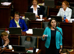 """FILE - In this Friday, May 12, 2017, file photo, Rep. Crystal Quade, D-Springfield, speaks before the end of the last legislative session in the Missouri House in Jefferson City, Mo. After a record-setting election, women have made only modest gains among the top leadership positions in state legislatures. """"We are constantly fighting up against the history of having older white men in these positions,"""" said Missouri House Minority Leader Quade, a social worker chosen for the top Democratic spot this session after serving just two years in the House. (Christian Gooden/St. Louis Post-Dispatch via AP, File)"""