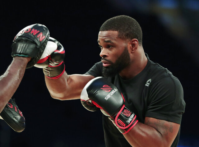 FILE - In this Nov. 9, 2016, file photo, Tyron Woodley works out ahead of his UFC 205 mixed martial arts bout against Stephen Thompson during an open workout at Madison Square Garden in New York. Mixed martial arts and boxing are back in business in Nevada. The Nevada Athletic Commission unanimously agreed during a teleconference Wednesday, May 27, 2020, to allow two UFC events and two Top Rank boxing shows in Las Vegas over the next two weeks. The UFC show Saturday, May 30, will be headlined by former welterweight champion Woodley facing Gilbert Burns. (AP Photo/Julio Cortez, File)