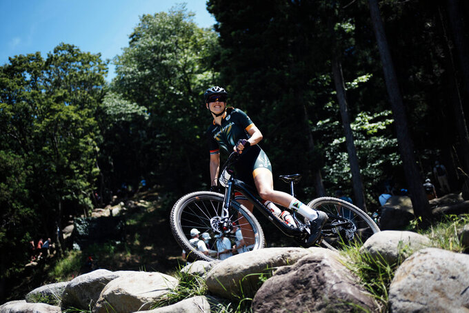 Candice Lill of South Africa smiles during a training for the mountain bike cycling race, at the 2020 Summer Olympics, Friday, July 23, 2021, in Izu, Japan. (AP Photo/Thibault Camus)