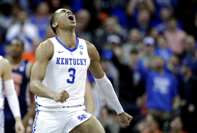 Kentucky's Keldon Johnson celebrates during the second half of the Midwest Regional final game against Auburn in the NCAA men's college basketball tournament Sunday, March 31, 2019, in Kansas City, Mo. (AP Photo/Charlie Riedel)