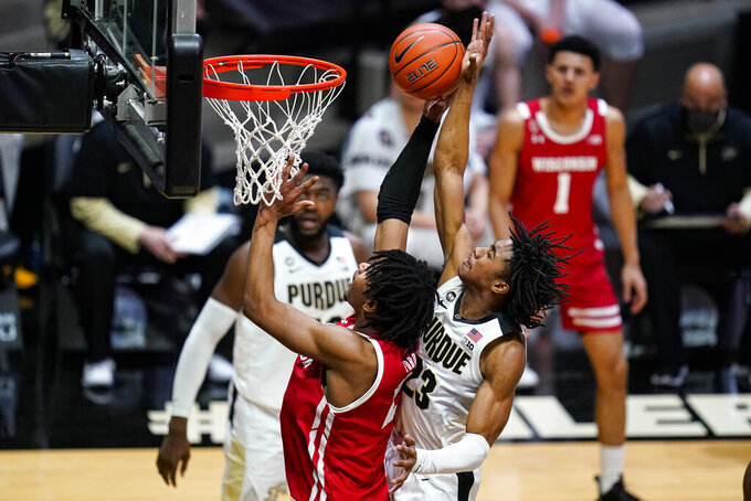 Purdue guard Jaden Ivey (23) comes from behind to block the shot of Wisconsin forward Aleem Ford (2) during the first half of an NCAA college basketball game in West Lafayette, Ind., Tuesday, March 2, 2021. (AP Photo/Michael Conroy)