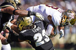 Minnesota running back Treyson Potts, right, is stopped after a short gain by Colorado safety Isaiah Lewis, center, and linebacker Guy Thomas in the first half of an NCAA college football game Saturday, Sept. 18, 2021, in Boulder, Colo. (AP Photo/David Zalubowski)