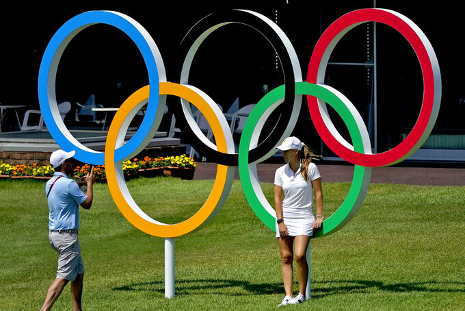 Magdalena Simmermacher, of Argentina, poses for a photo in front of the Olympic rings during a practice round prior to the women's golf event at the 2020 Summer Olympics, Tuesday, Aug. 3, 2021, at the Kasumigaseki Country Club in Kawagoe, Japan. (AP Photo/Matt York)