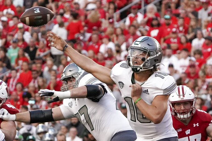 Eastern Michigan's Preston Hutchinson throws during the first half of an NCAA college football game against Wisconsin Saturday, Sept. 11, 2021, in Madison, Wis. (AP Photo/Morry Gash)